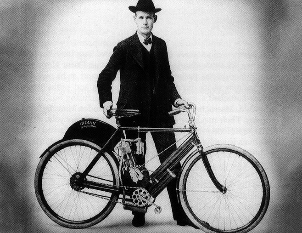 Indian Motorcycle co-founder Carl Oscar Hedstrom with a vintage Indian bike