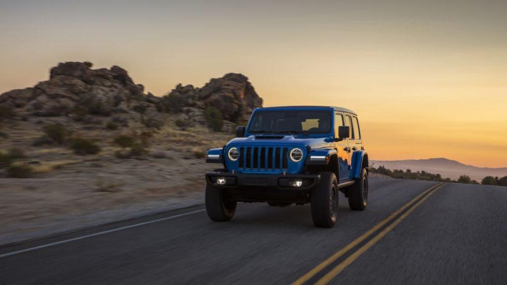 The 2021 Jeep Wrangler Rubicon 392 driving around desert roads at dusk