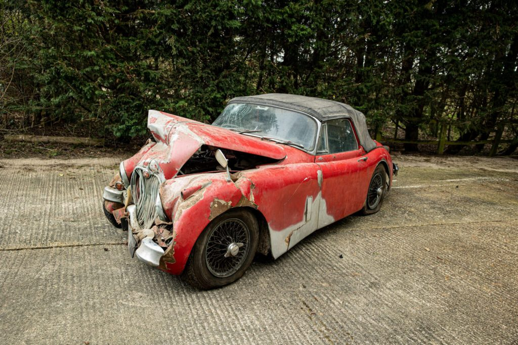 smashed red 1960 Jaguar XK 150S is going to auction at Bonhams