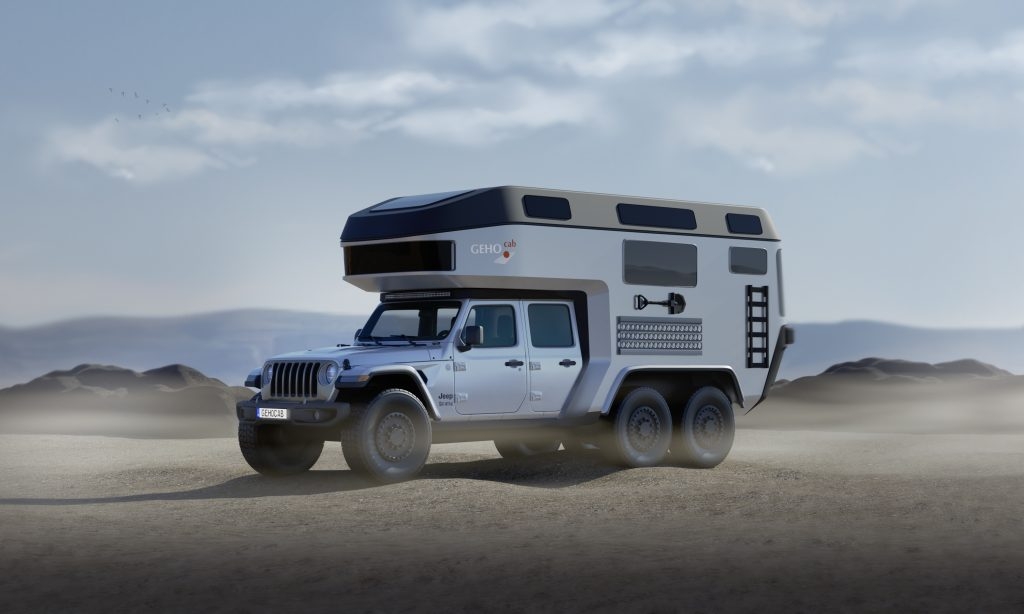 An image of a Jeep Gladiator with a custom-built carbon fiber camper.