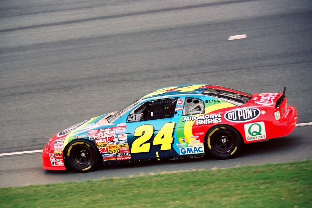 Jeff Gordon and his rainbow Chevrolet during a 1997 NASCAR race.