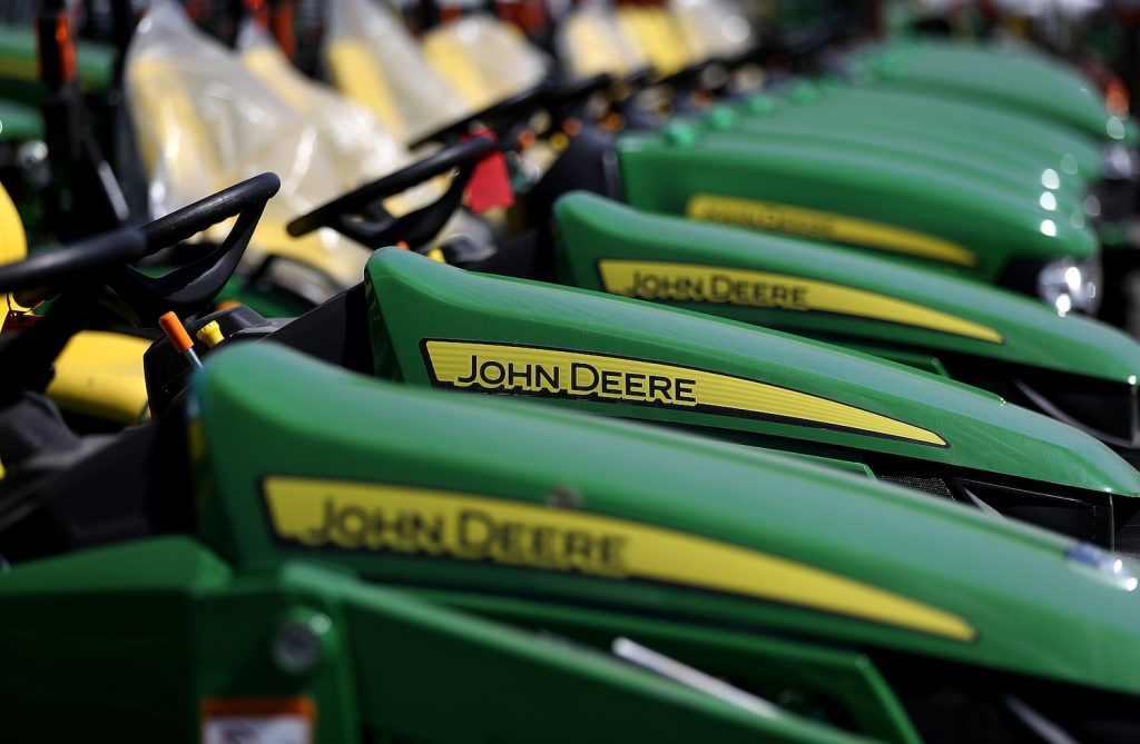 John Deere riding lawn mowers in front of a store