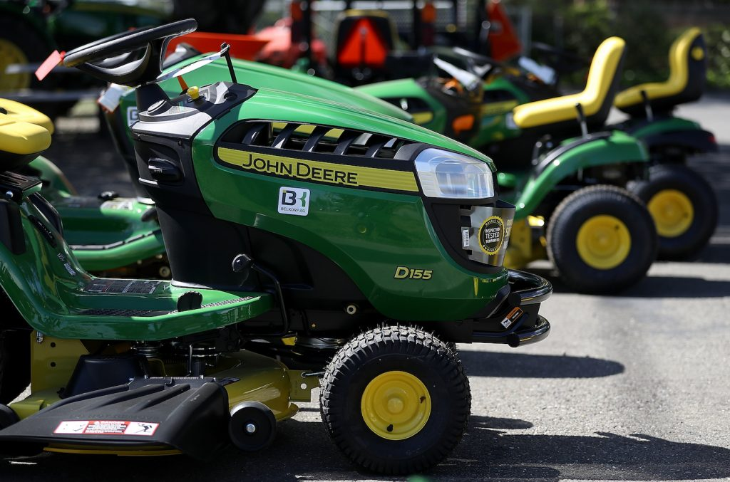 A lineup of John Deere riding lawn mowers, John Deere is one of the most reliable lawn mower brands