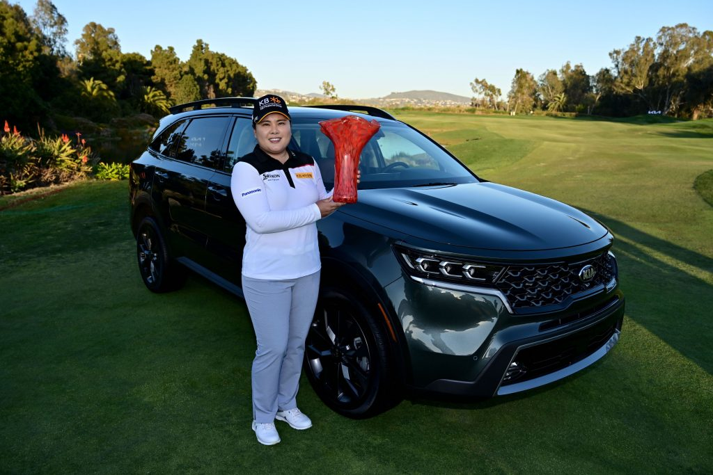 Inbee Park of South Korea poses with the winner's trophy and her black 2021 Kia Sorento after her -14 under par victory during the Final Round of the KIA Classic at the Aviara Golf Club
