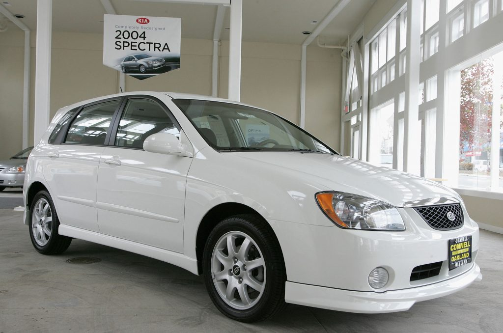 A white Kia Spectra on display at a showroom in Oakland, California makes our list of ugly cars.