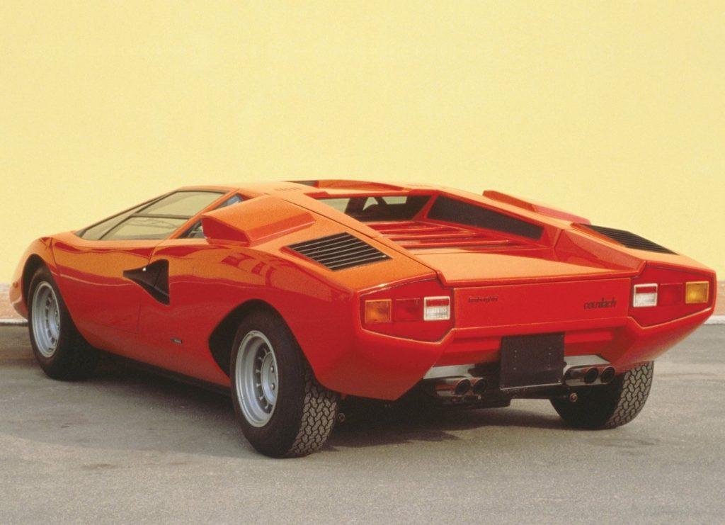 An image of a red Lamborghini Countach LP400 parked outdoors.