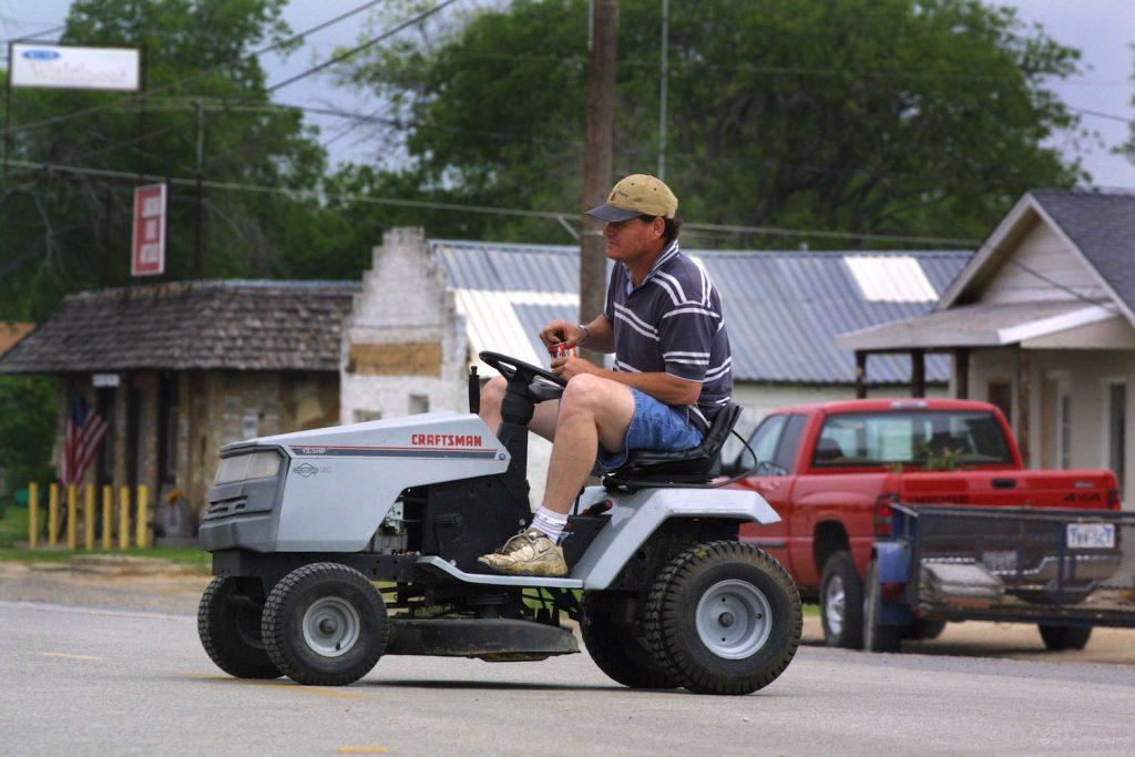 A lawnmower in the street