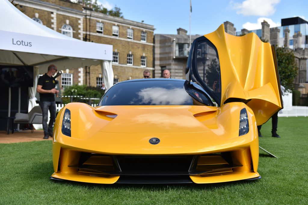 A fully electric yellow Lotus Evija hypercar is displayed during the London Concours at Honourable Artillery Company