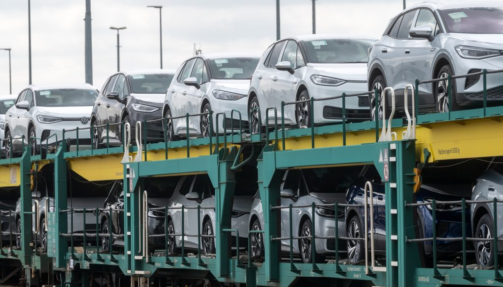 A train full of cars on their way to dealerships.