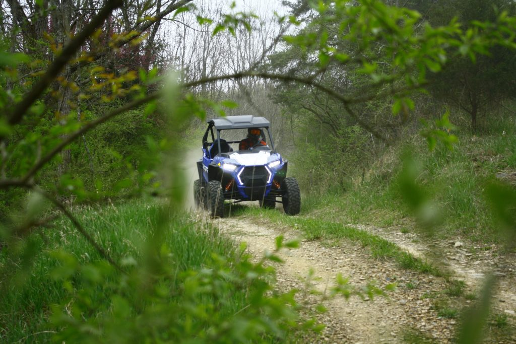 2021 Polaris RZR Trail S Sport ripping through a wooded trail