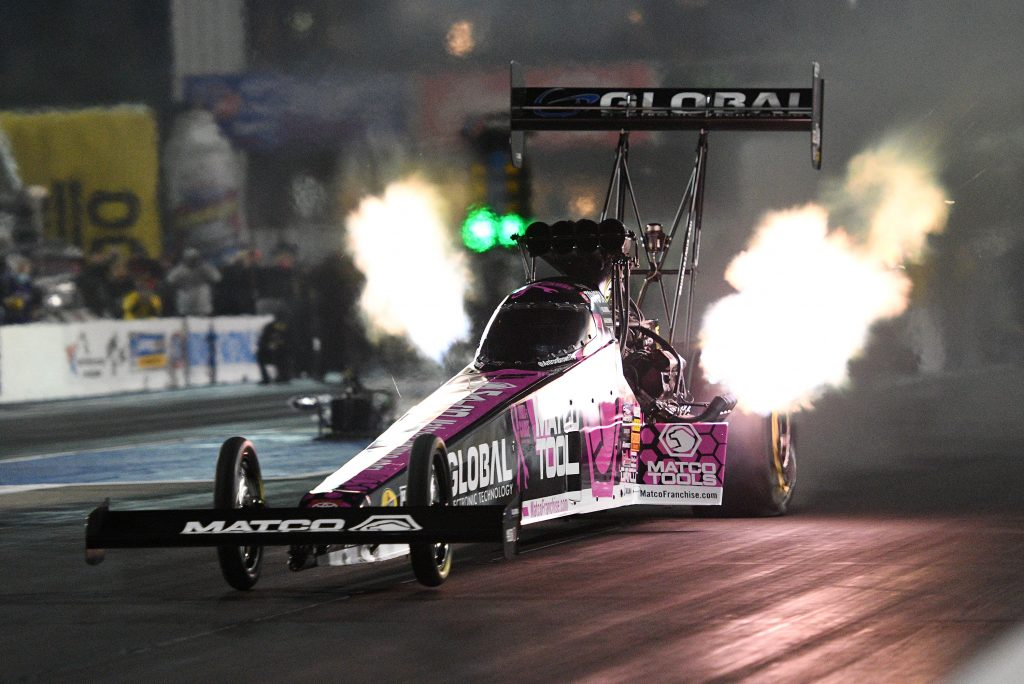 A dragster shoots flames. The Matco Tools dragster won in the first eliminating round of the 2021 SpringNationals.