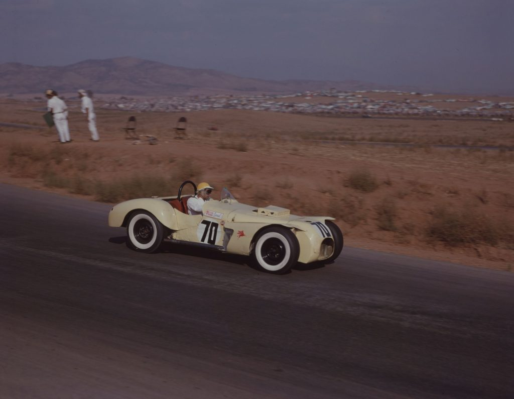 Max Balchowsky driving the pale-yellow Old Yeller I at the 1958 Times Grand Prix