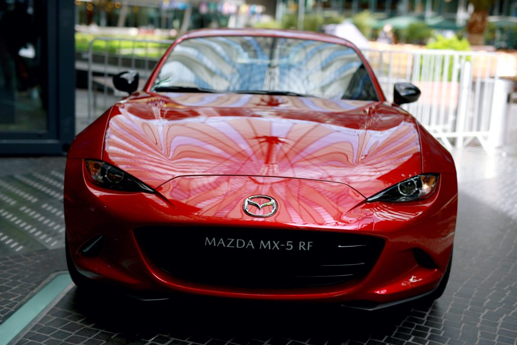 The roof of the Sony Center reflects on the bonnet of the red Mazda MX-5 RF during the Mazda Spring Cocktail at Sony Centre
