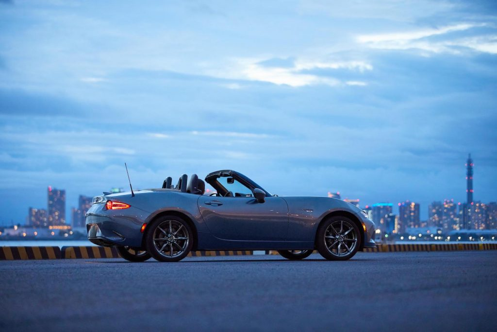 A 2021 Mazda Miata parked at sunset, the Miata is an affordable new car