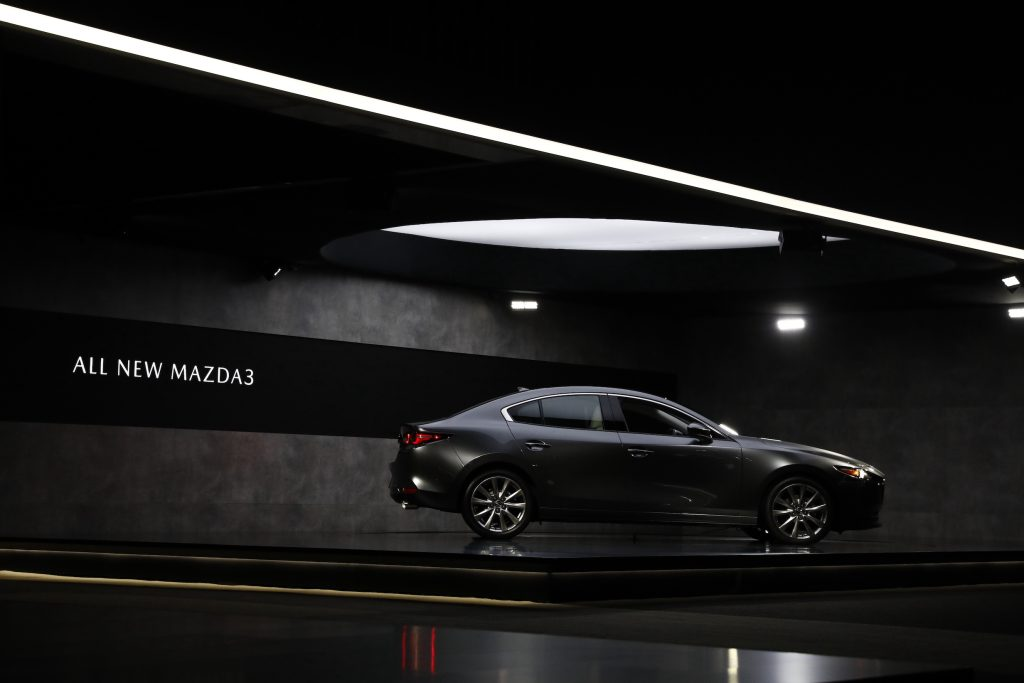 A gray Mazda Motor Corp. Mazda3 sedan is displayed during AutoMobility LA ahead of the Los Angeles Auto Show