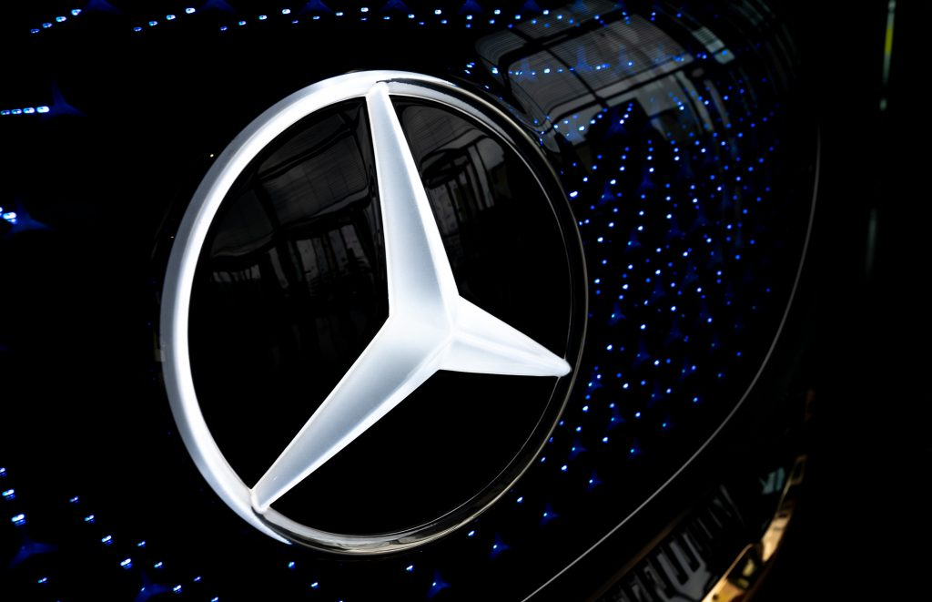 A Mercedes-Benz symbol on the front of one of the safest midsize luxury SUVs, a Mercedes-Benz GLE.