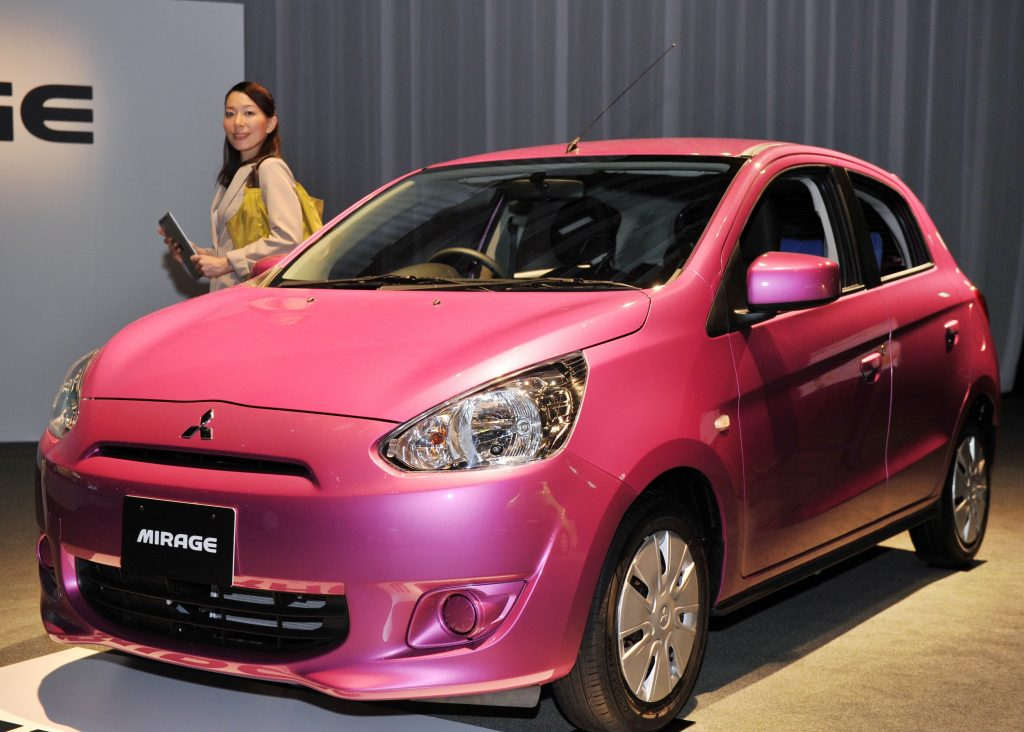 On our list of most hated cars of all time is the Mitsubishi Mirage, which takes center stage in a Tokyo showroom.