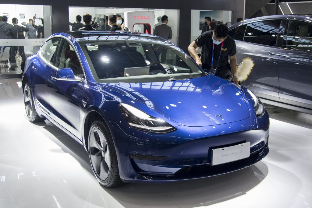 A blue 2021 Model 3 on display.