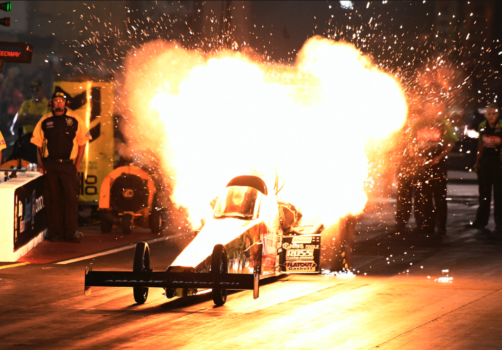 fire, flames and nitro of NHRA Top Fuel drag racing