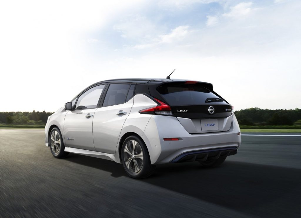 An image of a white Nissan LEAF parked outdoors.