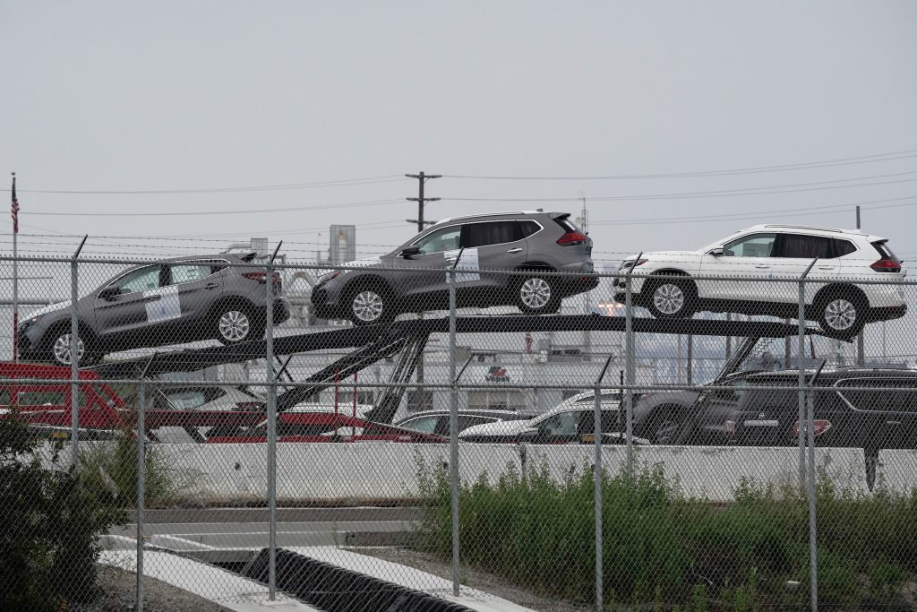 New Nissan Motor Co. Rogue vehicles sit on a car carrier trailer inside an automotive processing terminal operated by WWL Vehicle Services Americas Inc.
