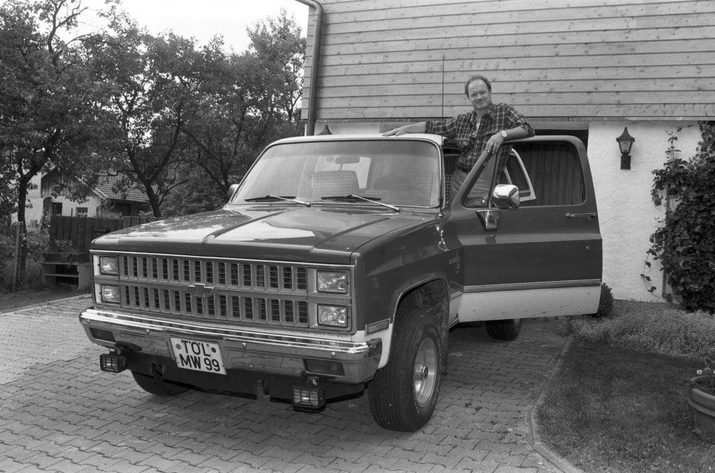 A man and his old Chevy Blazer, circa 1980s.