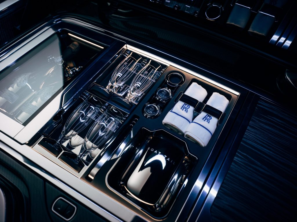 Boat Tail branded silverware in the back compartment of the new Rolls, including champagne.