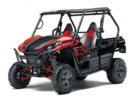 a red and black 2021 Kawasaki Teryx model in a press photo against a white backdrop