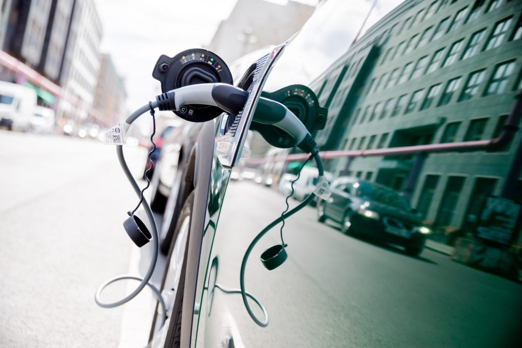 A plug-in hybrid car charges batteries at a station in the Berlin-Mitte district of the German capital.