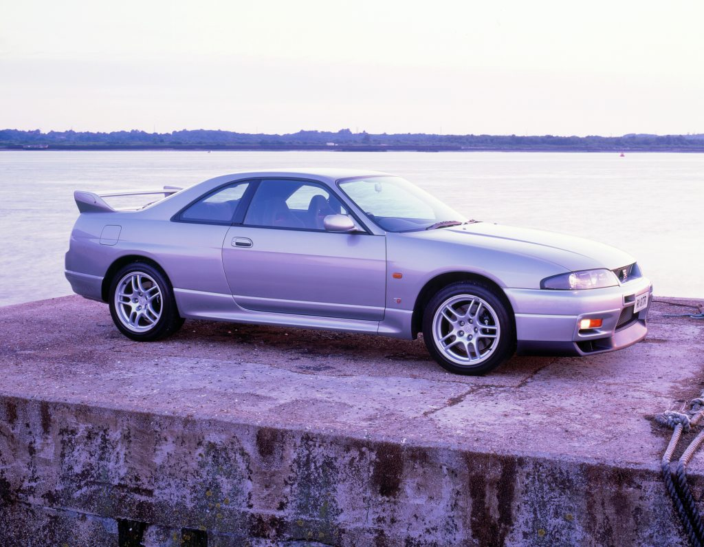 An image of a silver Nissan Skyline GT-R parked outdoors.