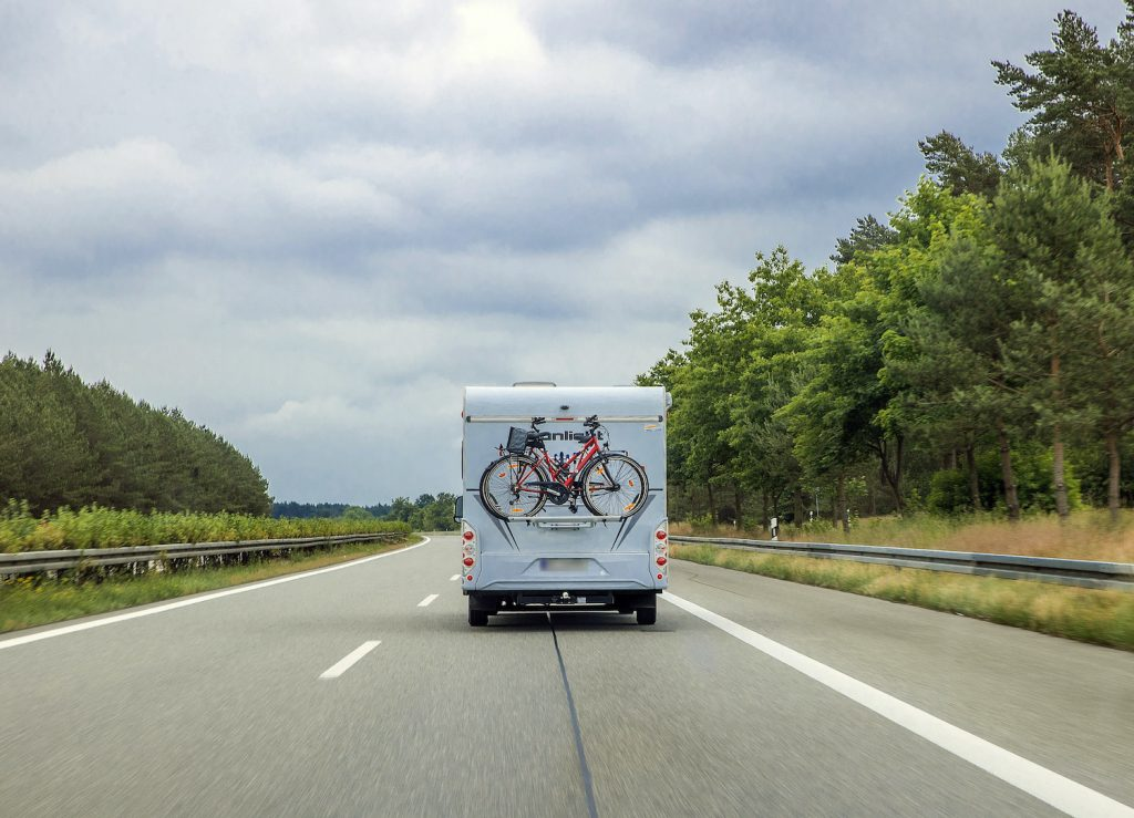 An RV driving down the road.