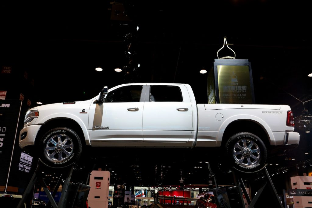 A white Ram 1500 on display at an auto show