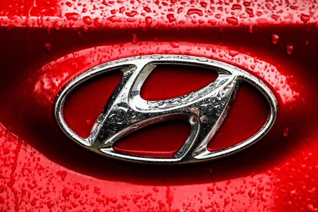 Pictured is the Hyundai logo on a red car, Hyundai recently recalled more than 390,000 cars.