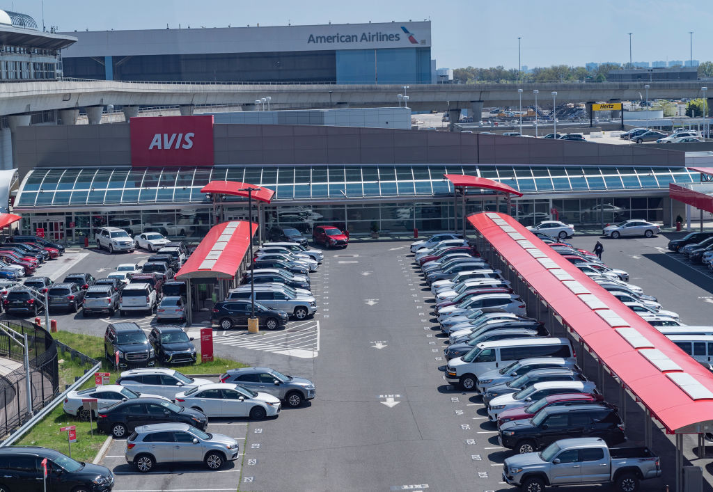 A lot of rental cars at an airport