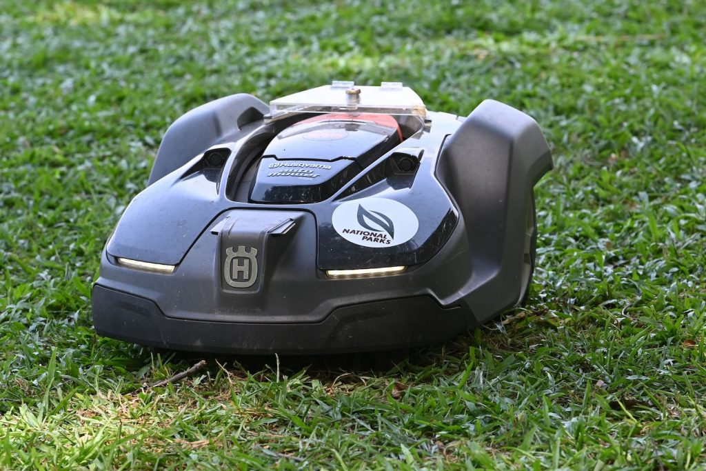 A robotic lawn mower mowing grass