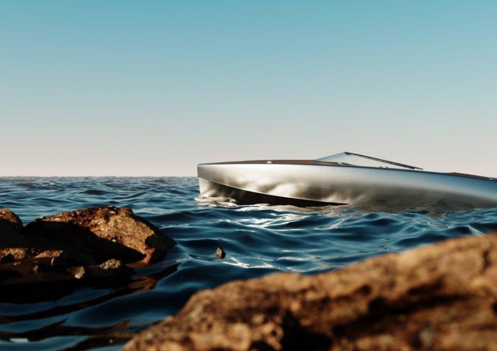 polished aluminum hull floating amongst the rocks