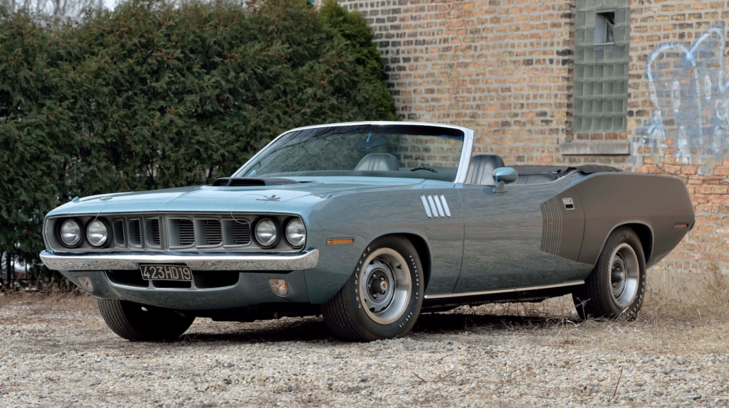 An image of a Plymouth Hemi Cuda Convertible parked outdoors.