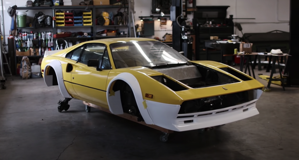 An image of a widebody Ferrari in a workshop.