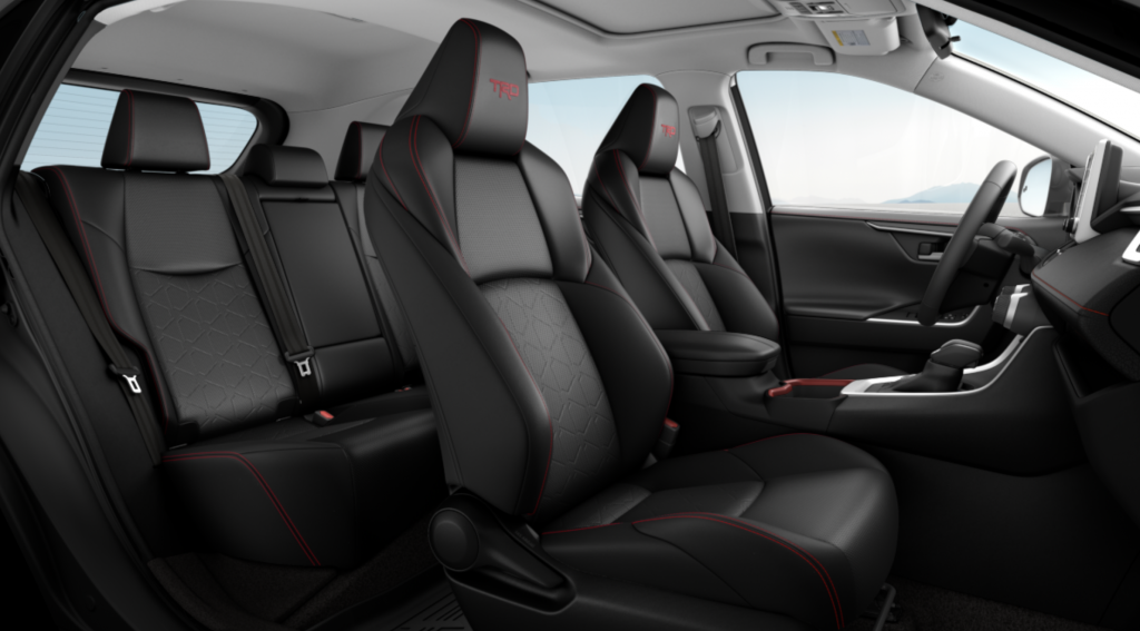 """The interior of a Toyota RAV4 with """"TRD"""" stitched into the headrests."""