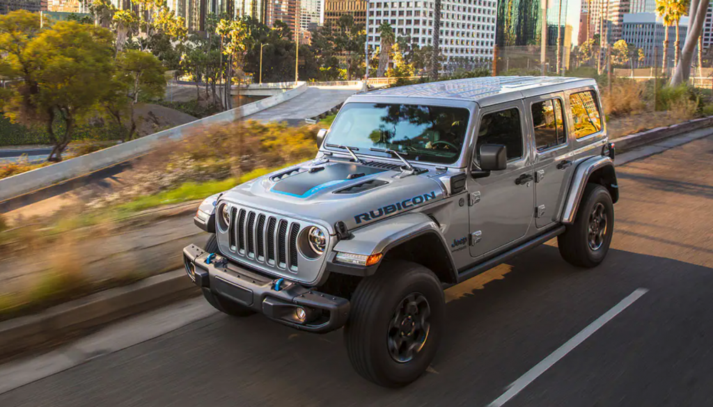 The 2021 Jeep Wrangler 4xe driving on a city street