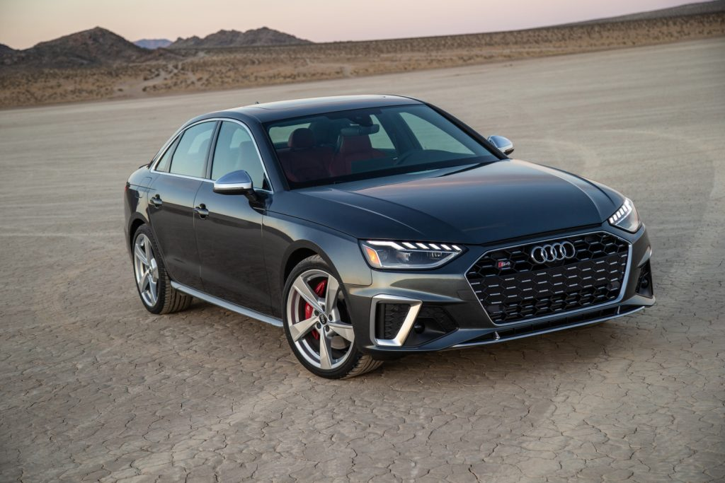 A grey 2021 Audi S4 in the desert at sunset