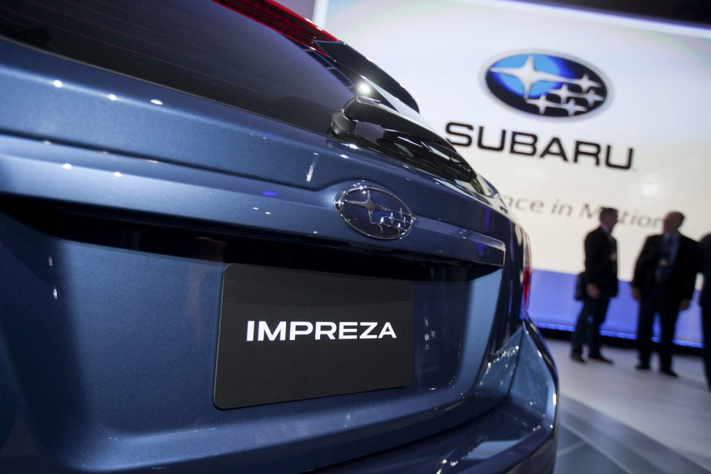 The rear of a Fuji Heavy Industries Ltd. blue Subaru 2012 Impreza hatchback vehicle is seen at the New York International Auto Show (NYIAS) in New York