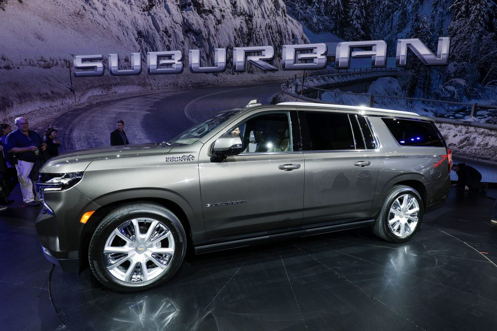 A 2021 Chevy Suburban is revealed at a car show. The Suburban is very similar to the GMC Yukon.