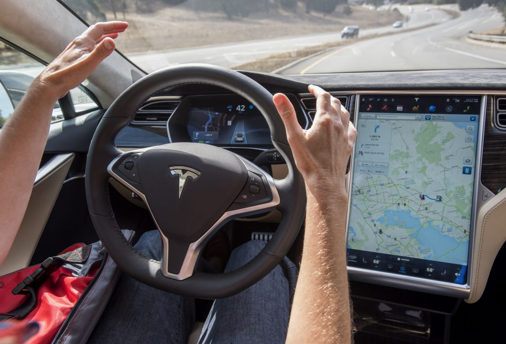 A driver goes hands free while using Tesla Autopilot.