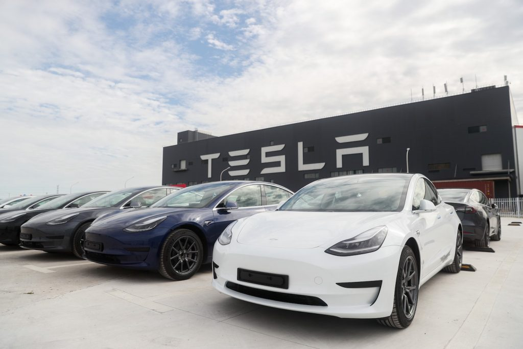 A lineup of Tesla Model 3s, one of the best luxury EVs according to Truecar