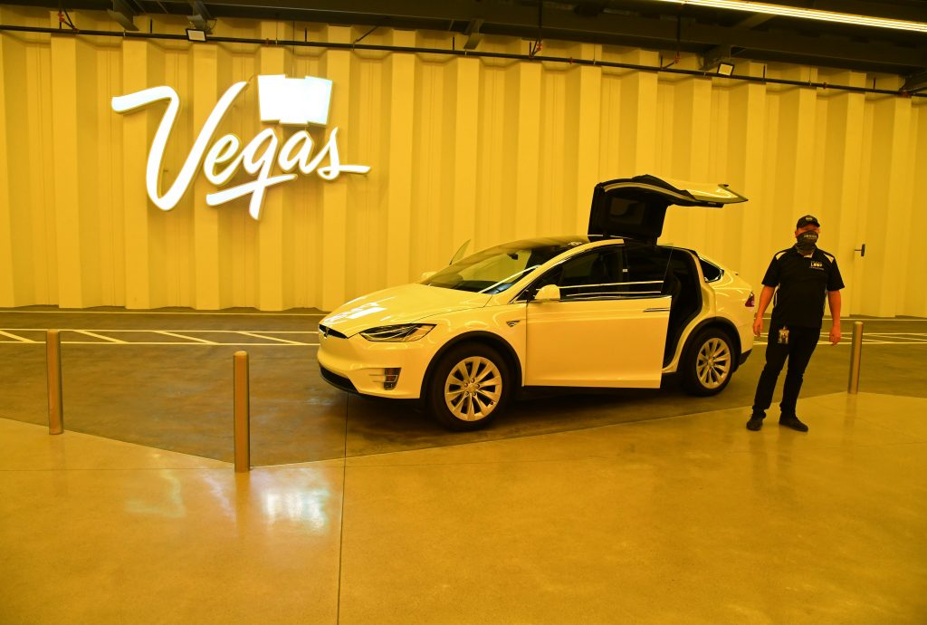 A white Tesla Model X is parked with the gull-wing doors up in the Central Station during a media preview of the Las Vegas Convention Center Loop