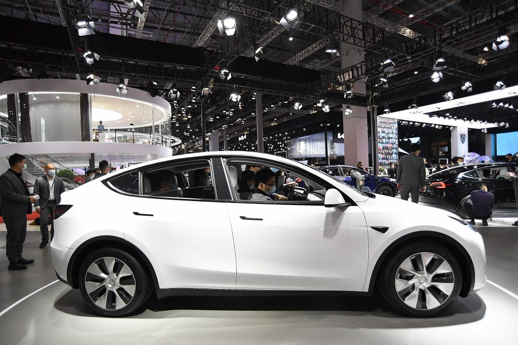A white 2021 Tesla Model Y. The Model Y is currently the top-selling EV.