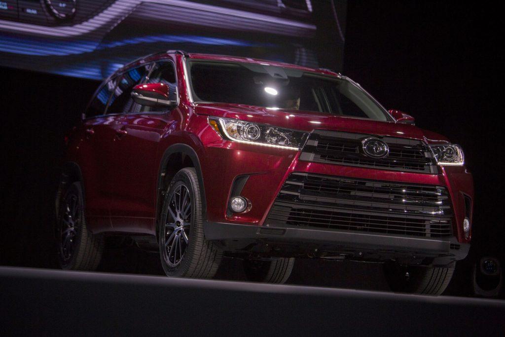 A red Toyota Highlander on display