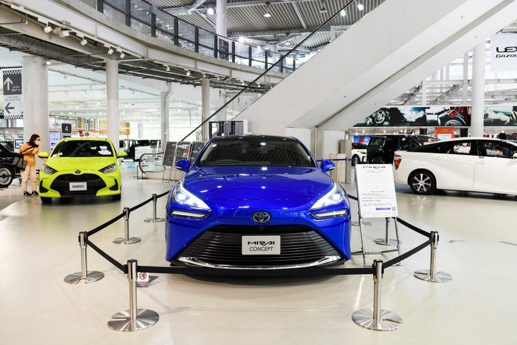 A blue 2021 Toyota Mirai on a showroom floor.