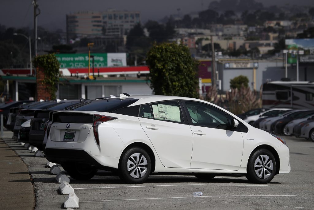 Brand new Toyota Prius cars are displayed on a sales lot at City Toyota on September 5, 2018